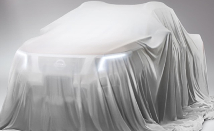 Nissan Navara teaser image in car cover from caranddriver.com
